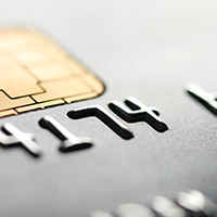 Close up of credit card numbers and EMV chip.